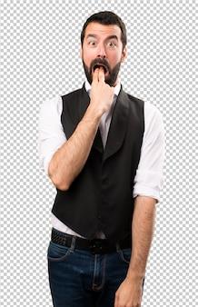 Cool man making vomiting gesture