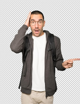 Cool student pointing with his finger