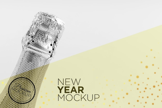 Copia spazio bottiglia di champagne mock-up nuovo anno