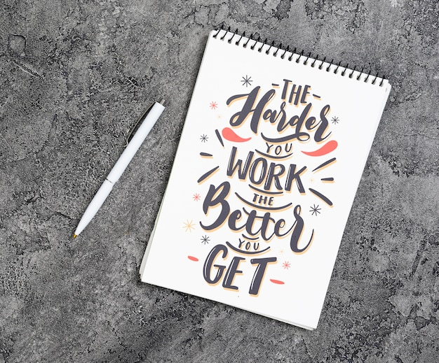 Copy-space notebook with inspirational message
