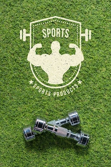 Copyspace mockup on grass with dumbbells