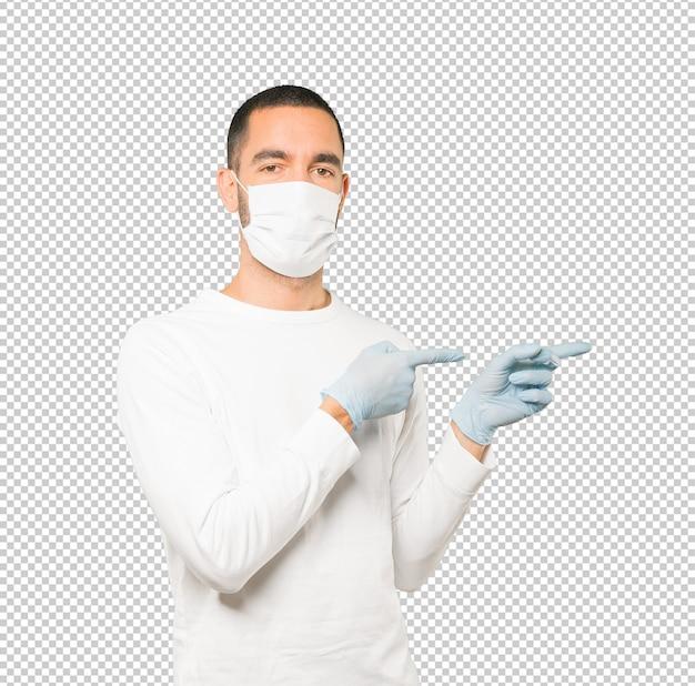 Coronavirus.young человек делает концепции и носить маску и защитные перчатки