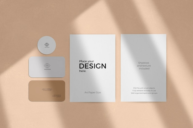 Corporate stationary set mockup with window shadow effect on a beige wall