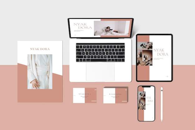Corporate stationery and laptop and tablet and phone top view premium psd
