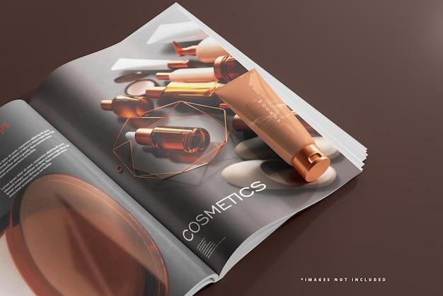 Трубка с косметическим кремом и макет журнала