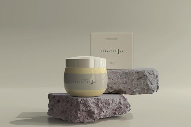 Cosmetic jar and box mockup on rocks