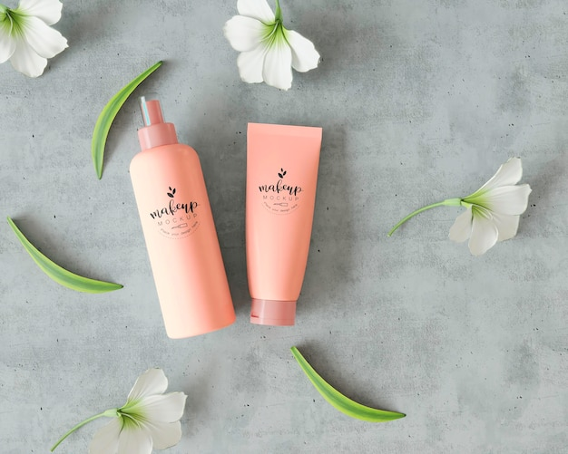 Cosmetic products on cement surface with flowers