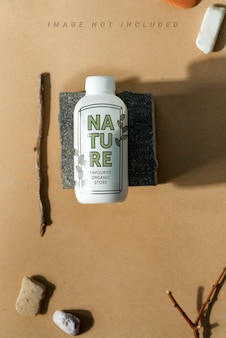 Cosmetic set from mock-up bottle and pumice-stone.
