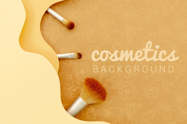 Cosmetics background with brush set