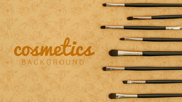 Cosmetics background with brushes