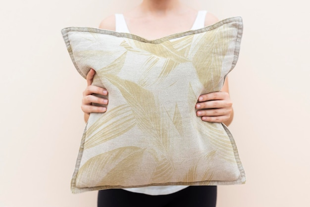 Cotton cushion cover mockup psd in floral pattern living concept