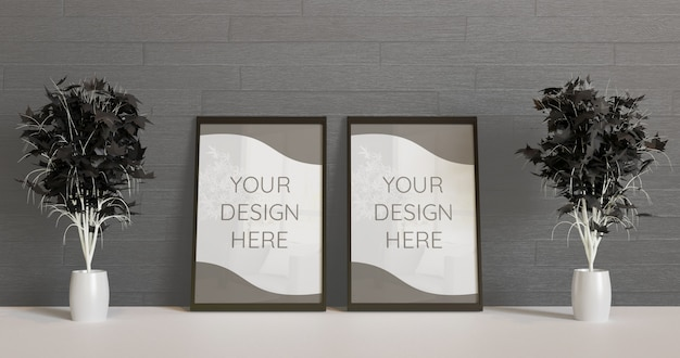 Couple black frame mockup standing on the floor with couple black decorative plants