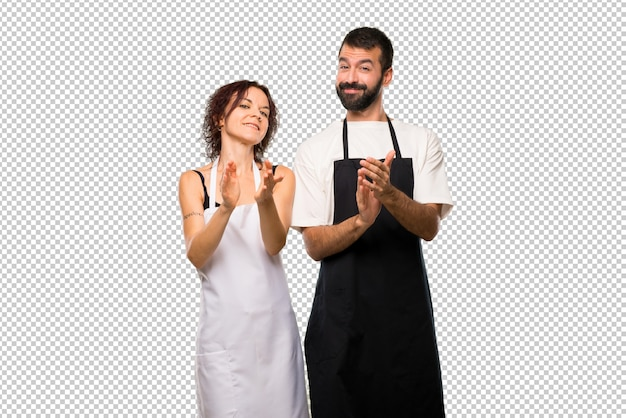 Couple of cooks applauding after presentation in a conference