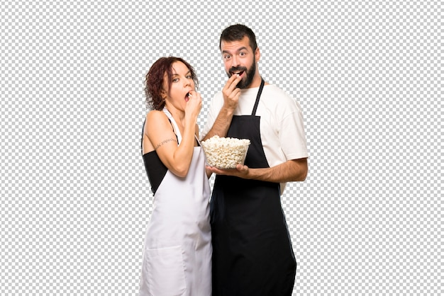 Couple of cooks eating popcorn