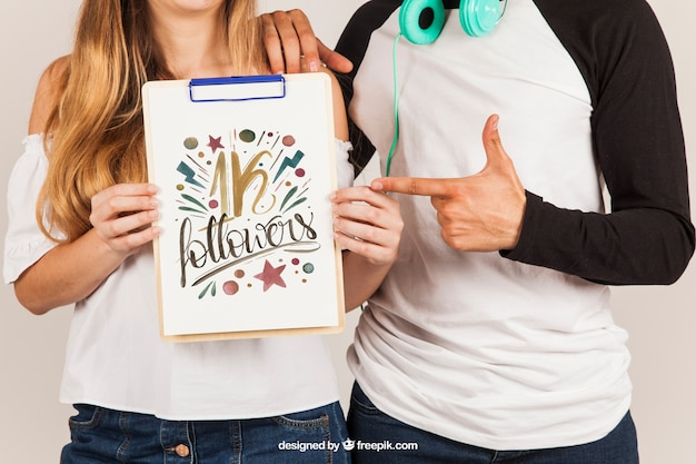 Couple holding clipboard