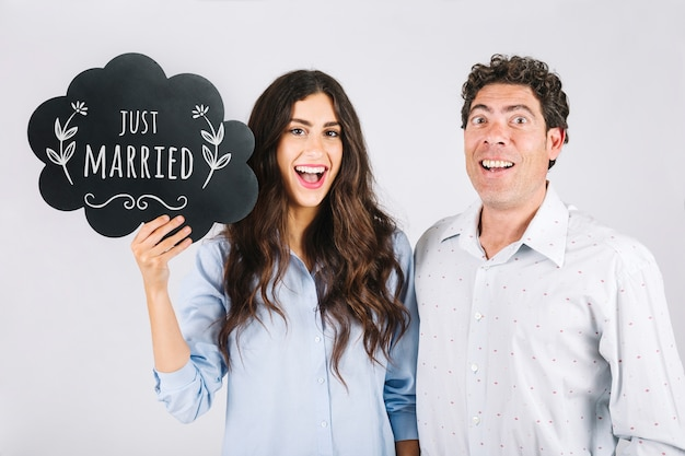 Couple holding speech bubble slate