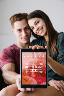 Couple holding tablet mockup for valentine