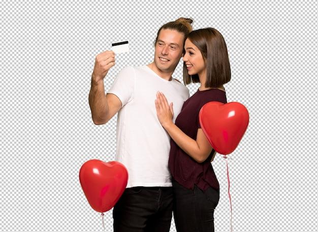 Пара в день святого валентина, проведение кредитной карты и мышления