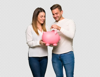 Couple in valentine day taking a piggy bank