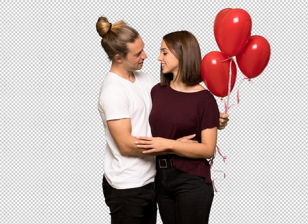 ハートの形の風船でバレンタインデーのカップル