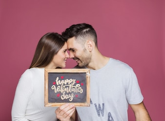 Couple presenting slate mockup