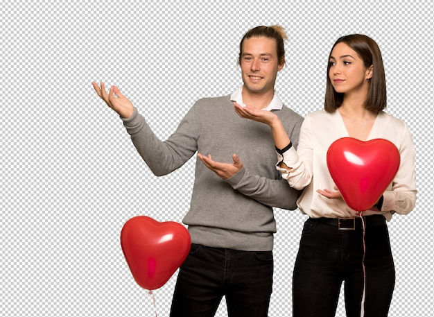 Couple in valentine day extending hands to the side for inviting to come