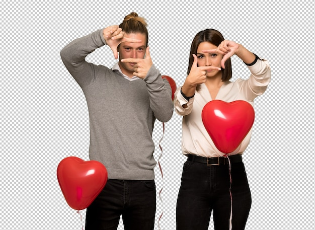 Couple in valentine day focusing face. framing symbol