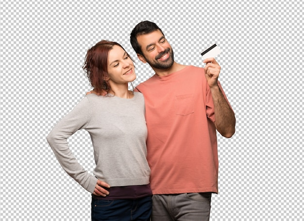 Couple in valentine day holding a credit card and thinking