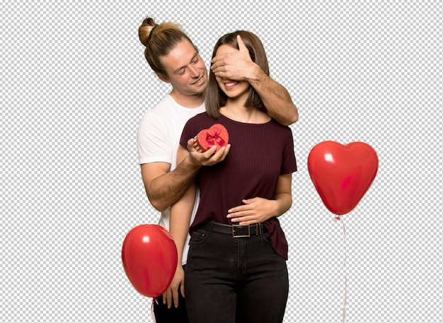 Couple in valentine day holding gift box