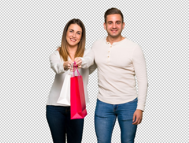 Couple in valentine day holding a lot of shopping bags