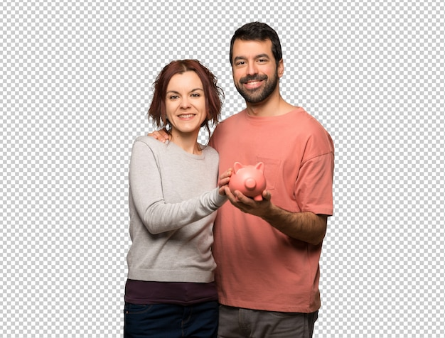 Couple in valentine day holding a piggybank