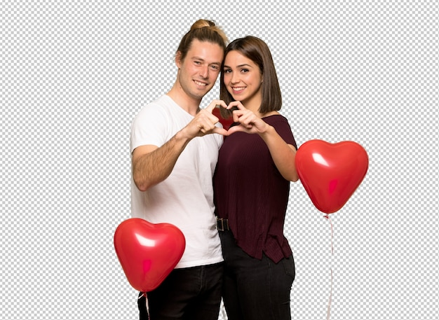 Couple in valentine day making a heart with hands