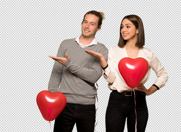 Couple in valentine day presenting an idea while looking smiling towards