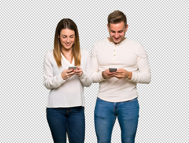 Couple in valentine day sending a message with the mobile