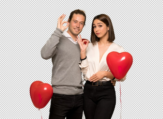 Couple in valentine day showing an ok sign with fingers