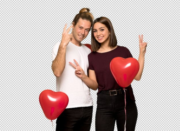 Couple in valentine day smiling and showing victory sign