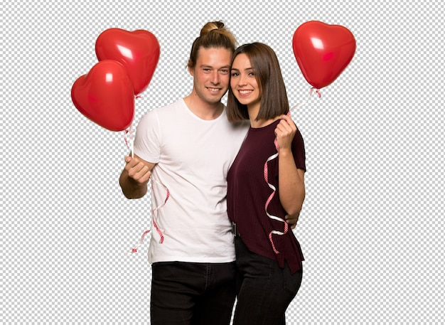 Couple in valentine day with balloons with heart shape