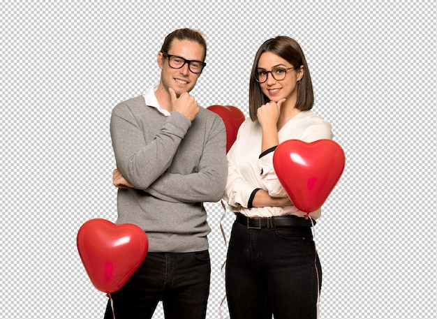 Couple in valentine day with glasses and smiling