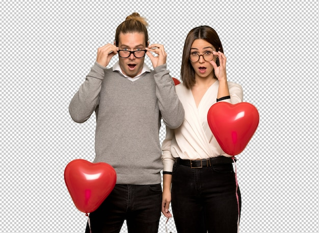 Couple in valentine day with glasses and surprised