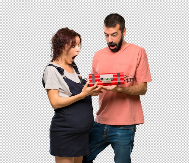 Couple with pregnant woman holding a bomb