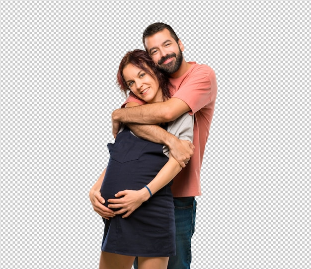 Couple with pregnant woman hugging