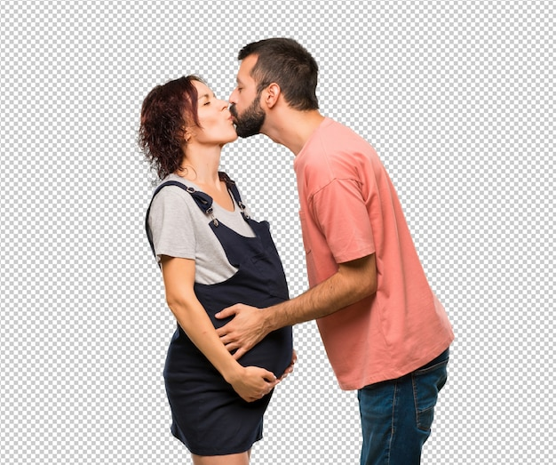 Couple with pregnant woman kissing