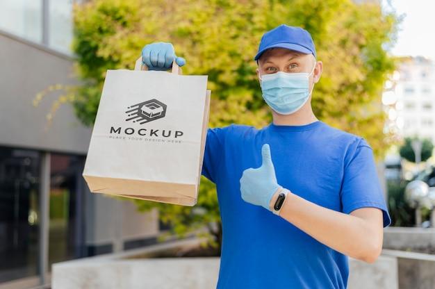Courier holding bag mockup