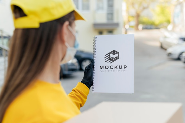 Courier holding notebook mockup