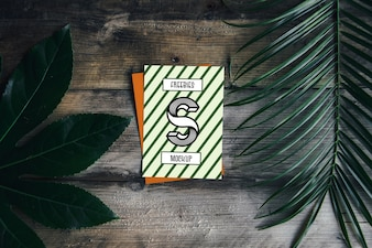 Cover mockup with palm leaves
