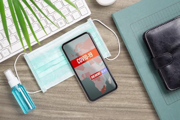 Covid-19速報ニュースコンセプトのモックアップ携帯電話。