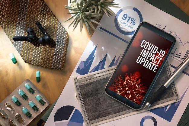 Covid19ビジネスインパクトコンセプトのモックアップ携帯電話
