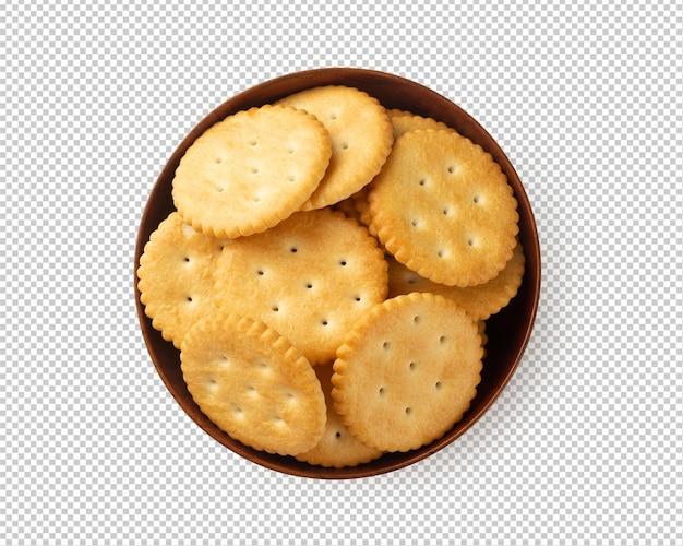 Крекер печенье в деревянной миске изолированы