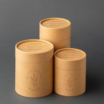 Mockup di design di cilindri di carta artigianale