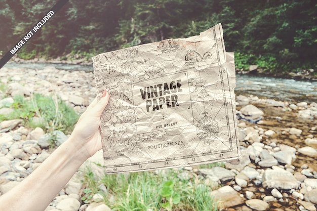 Craft paper in hand vintage concept mockup